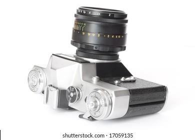 old retro film photo camera isolated on white