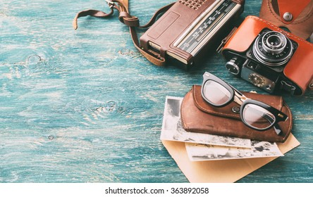 Old retro glasses, radio and Old retro camera on wooden background. May be used as background