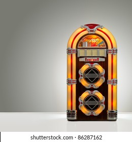 Old retro jukebox in an empty room with nice illumination, copy space ready