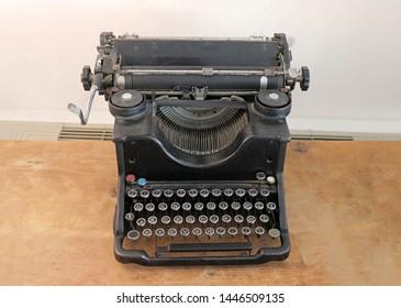 Old retro manual typwriter machine on wooden table