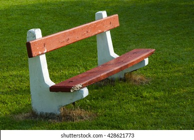 old retro park bench from concrete and wooden