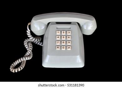 Old retro phone on black background.
