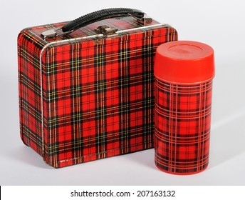 An old retro plaid lunchbox and thermos.
