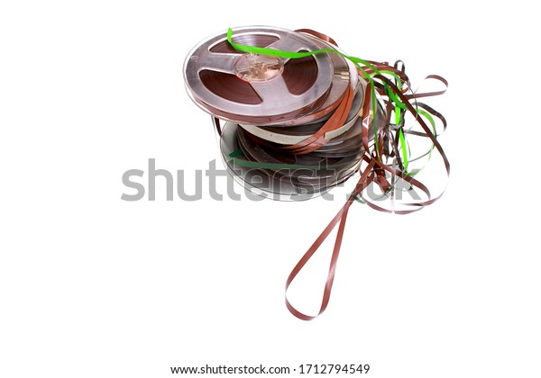 Old retro plastic  bobbins with magnetic tapes isolated on a white background
