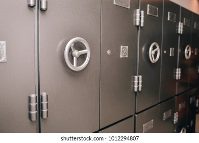 Old retro several safes. Horizontal, closeup view