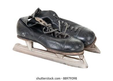 Old retro skates isolated over white background