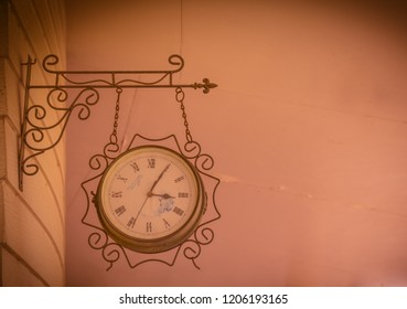 Old retro style hanging clock in lomography tone.