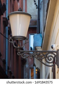 Old retro styled street lantern with electric lamp in the Ljubljana city. Metal antique streetlight for urban illumination in vintage design.
