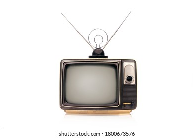 Old retro TV receiver set with antenna isolated on white background