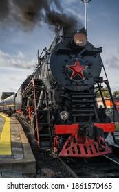 Old retro vintage steam train on platform station