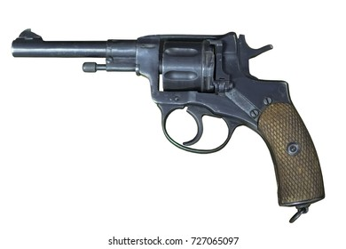 Old revolver of the Nagan system on a white background. Closeup. Retro. Isolated on white.