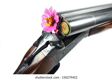 old rifle with a flower in the barrel