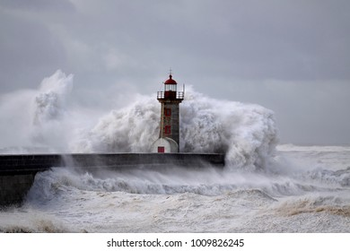 Old river Douro mouth lighthouse embrassed by sea waves superior to ten meters height originated by strong winds with gusts above 100 kilometers.