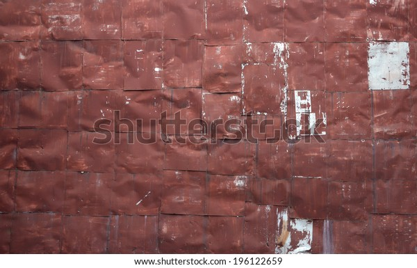 old riveted red metal sheet wall background