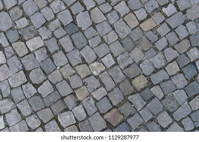 Old road with granite stones, old architecture of roads