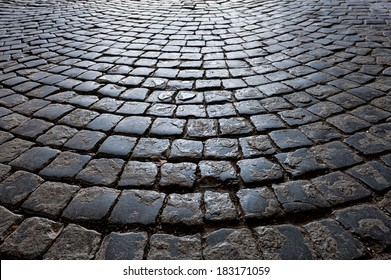 The old road is paved with stone setts