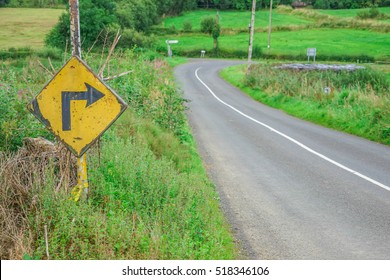 Old road sign, for a sharp right bend in the road, in rural Ireland.