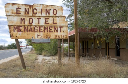 Old roadside motel in a small western town with mis-spelled sign