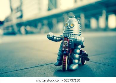 Old robot toy, vintage color style, vintage tone background.