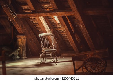 Old rocking chair in rustic vintage style attic. Memories concept.