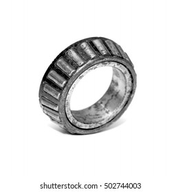 old roller bearing with traces rust, isolated on white background.