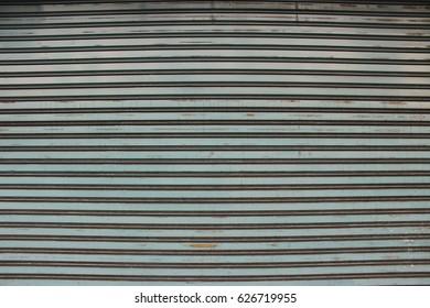 Old roller shutter. Vintage door. Texture.