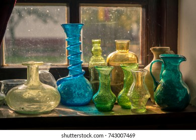 old Roman glass bottles beautifully lit by the sun light that comes throught the window.