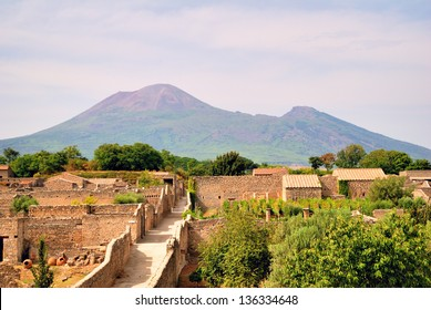 Old Roman Pompeii ruins with mount Vesuvio in the background