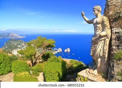 Old Roman statue decorates a building on top of Monte Solaro, Capri island, Italy