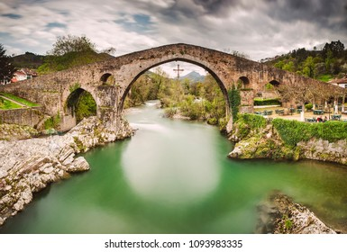 Old Roman stone bridge in Cangas de Onis (Asturias), Spain in a sunny day