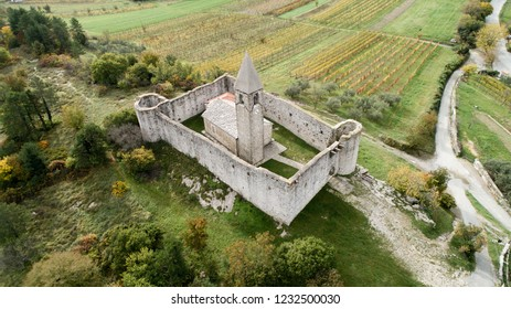 Old Romanesque church of Holly Trinity within defensive fortress walls in Karst village of Hrastovlje in Istria, Slovenia