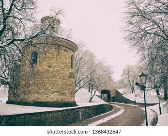 Old romanesque rotunda (church) of st Martin from 11th century. In Vysehrad fortress (Vysehrad castle) in Prague in snowy day in winter. Rotunda of st Martin is the oldest rotunda in Prague – Czech.