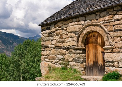 Old Romanesque wooden cross and door of the Sant Quirc de Taull , Catalonia, Spain. Catalan Romanesque Churches of the Vall de Boi are declared a UNESCO World Heritage Site Ref 988