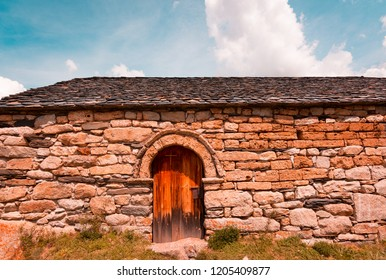 Old Romanesque wooden door of the Sant Quirc de Taull , Catalonia, Spain. Catalan Romanesque Churches of the Vall de Boi are declared a UNESCO World Heritage Site. Filters effect teal and