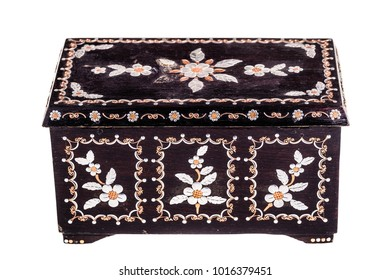 an old romanian black wooden box with mother of pearl decorations isolated over a white bachground