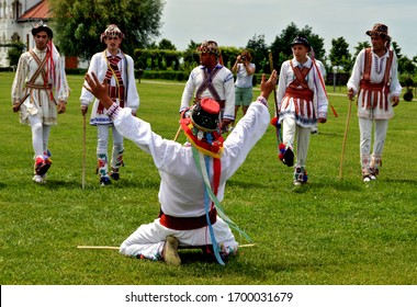 """Old Romanian tradition called """"calusari"""", men performing traditional dance """"calus"""" during spring festivities, rustic Easter traditions - Dragasani, Dolj / Romania - 5/28/2018"""