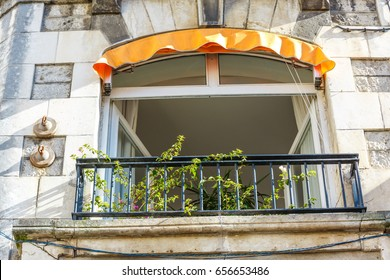 Old Romantic Balcony with plants and flower