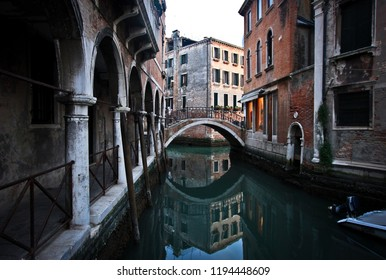 Old romantic bridge on the canal in Venice