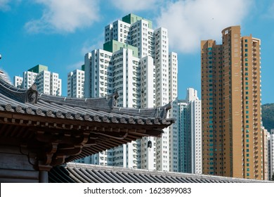 old roof detail, traditional Chinese architecture and skyscraper buildings in background, HongKong -