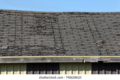 Old roof in disrepair with aged shingles