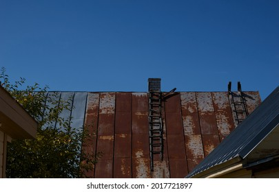 old roof of the house, on it a wooden staircase . High quality photo