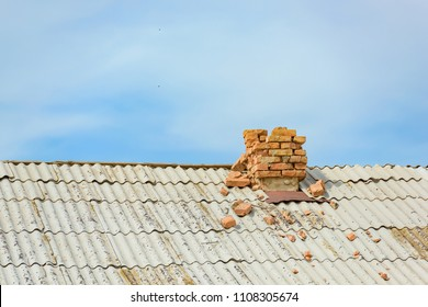 The old roof of the house. Shelter of slate. Broken chimney