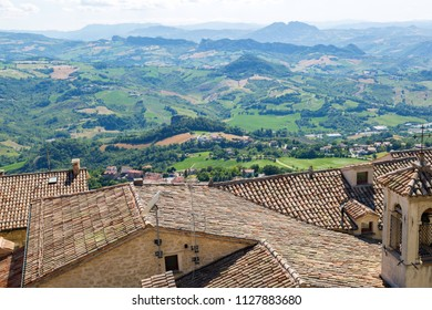 Old roofs and San Marino landscape.