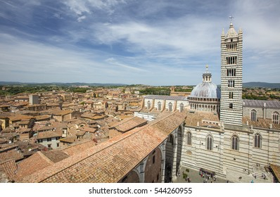 old roofs and view to the cathedral in Tuscany city