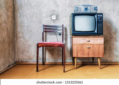 old room. retro tv, chair and cassette player