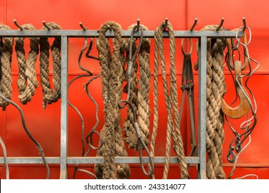Old ropes closeup photo hanging on wall