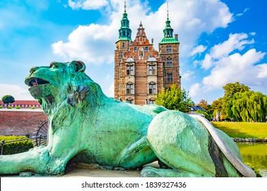 Old Rosenborg Castle in Copenhagen city, Denmark. Selective focus on a lion on foreground.