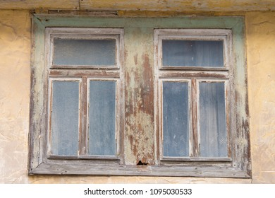 Old rotten window in an old facade