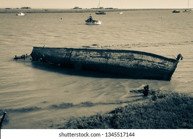 Old rotting boat in the Ore Estuary, Suffolk, UK.