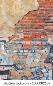 Old Rough Graffiti Grunge Colorful Brick Wall With Abstract Pattern, Vertical Background Or Texture. Old Red Urban Brickwall With Grafiti Street Art Elements And Details. Modern Street Art Concept